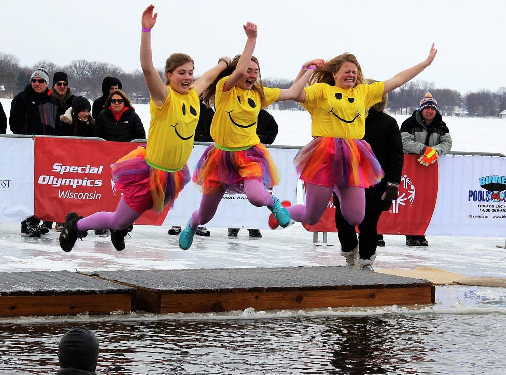 Three girls doing the Polar Plunge