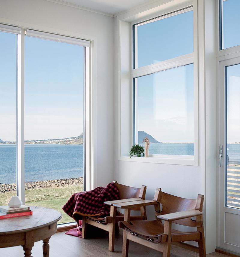 GLASSKLAR BESKYTTELSE: Glass med solskjerming legger grunnlaget for et koselig og harmonisk hjem.