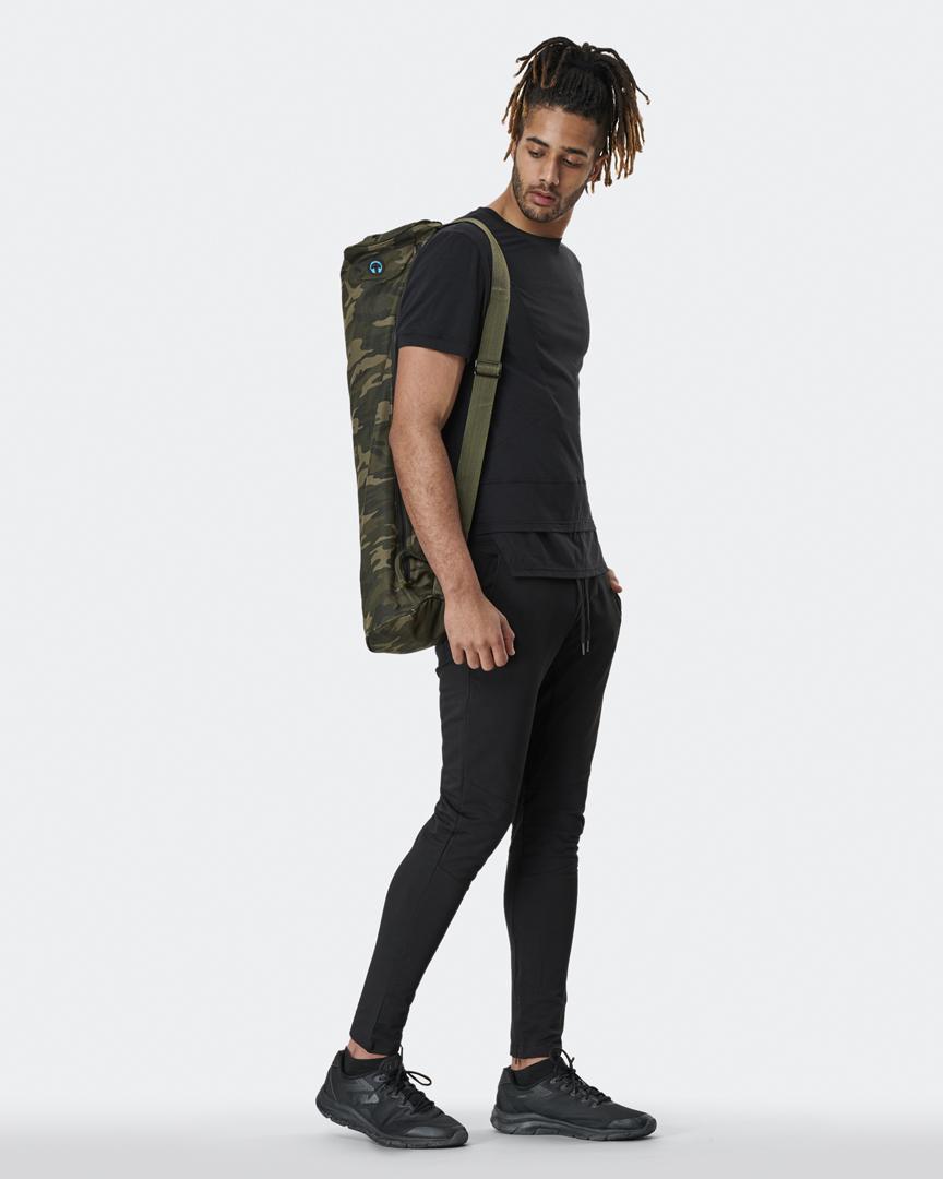 warrior addict mens yoga top a-symmetry t-shirt in black full body model shot