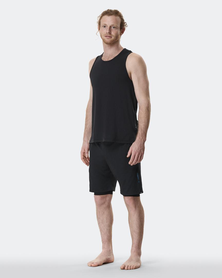 warrior addict mens yoga anti gravity shorts in black with under full length shot with Jacob Mellish
