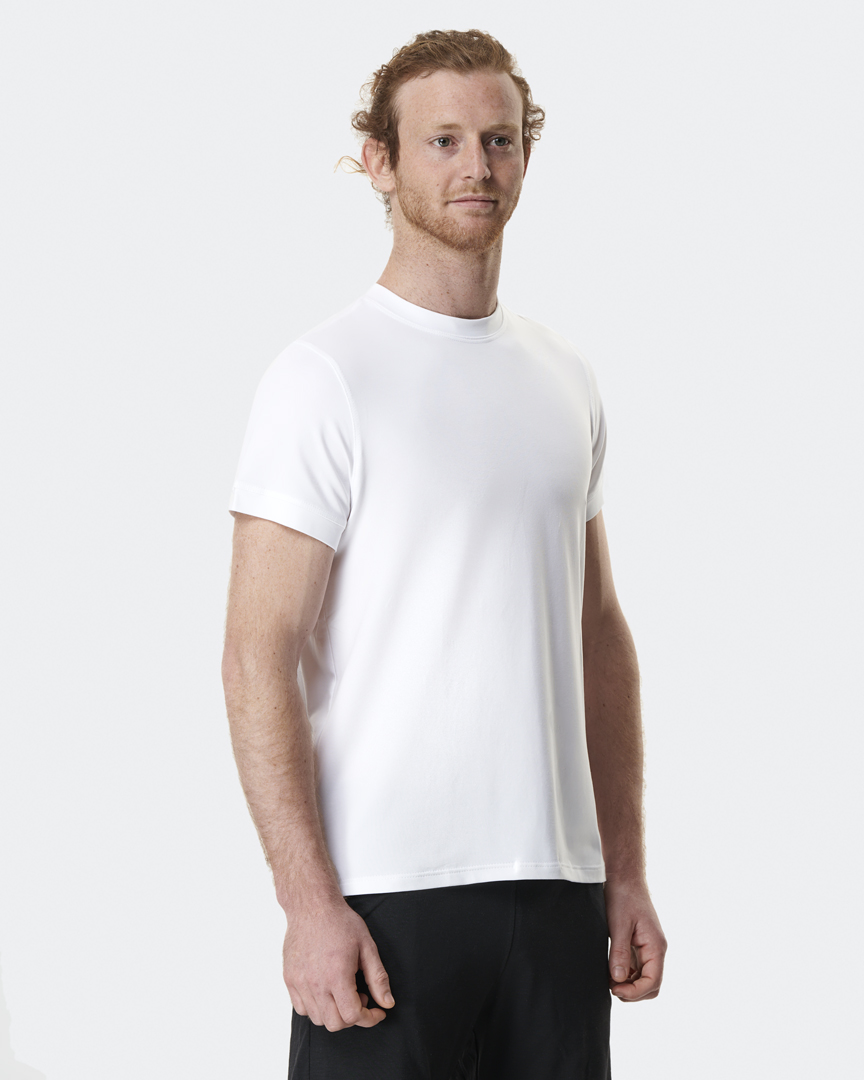 warrior addict mens yoga top performance tee white front model shot with Jacob Mellish