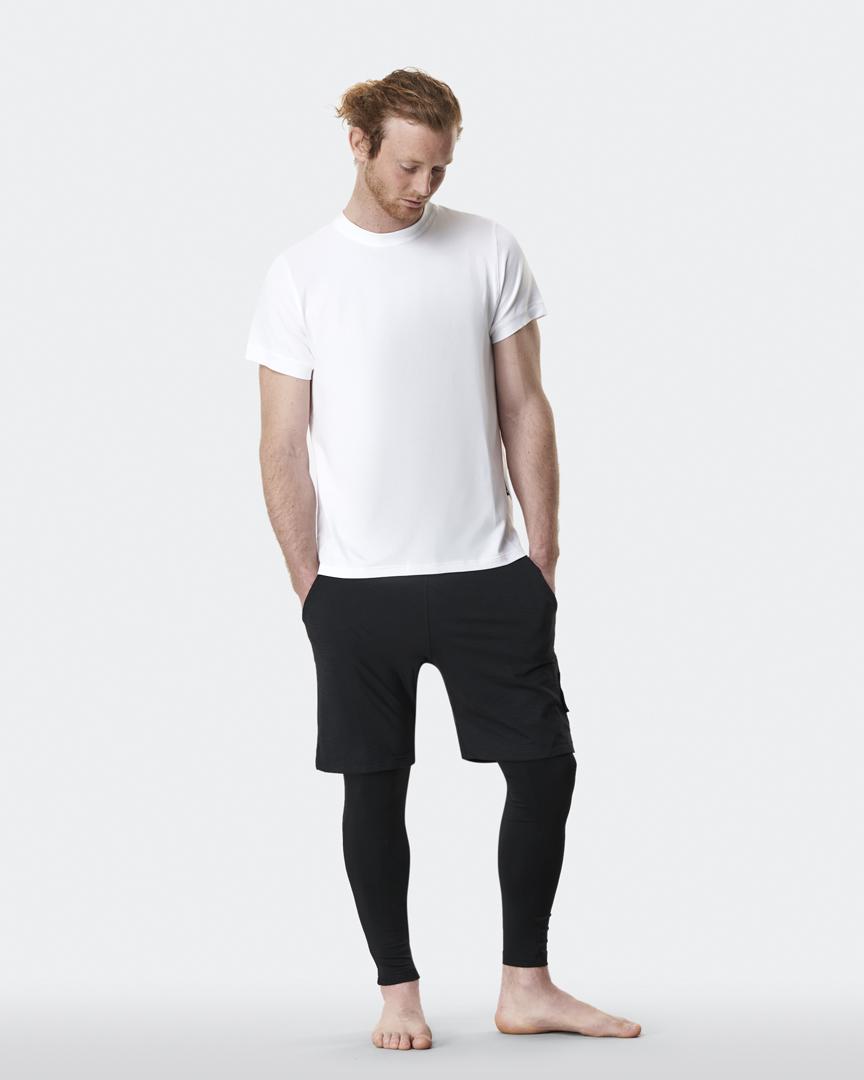 warrior addict mens yoga top performance tee white full body model shot with Jacob Mellish