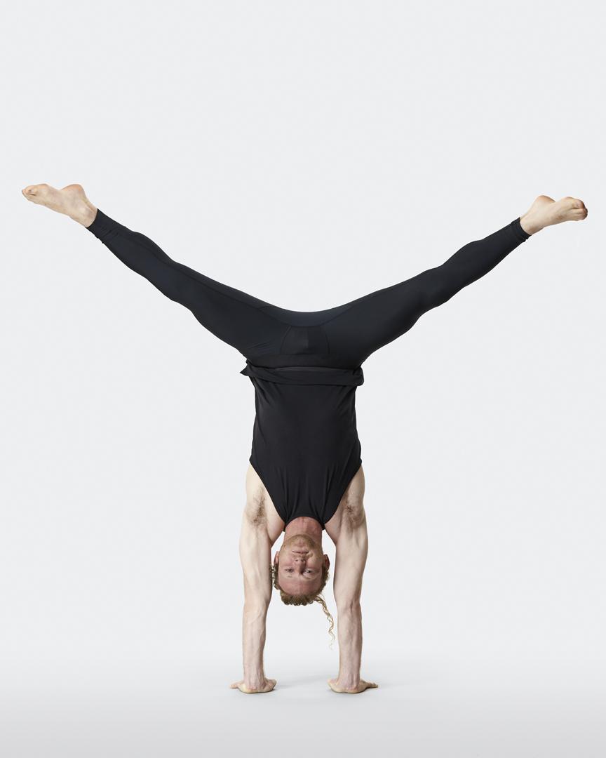 warrior addict mens yoga inversion tank in black model Jacob Mellish doing handstand