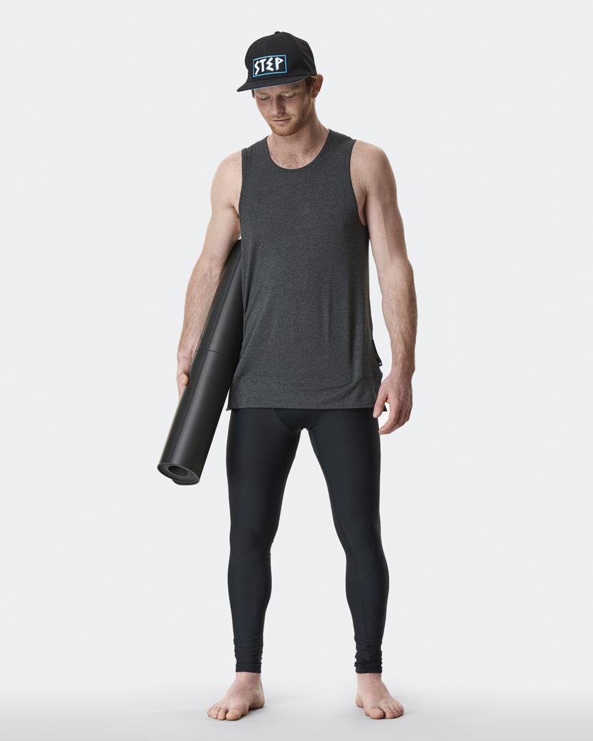 warrior addict mens yoga inversion tank top in grey worn by Jacob Mellish  carrying mens yoga mat