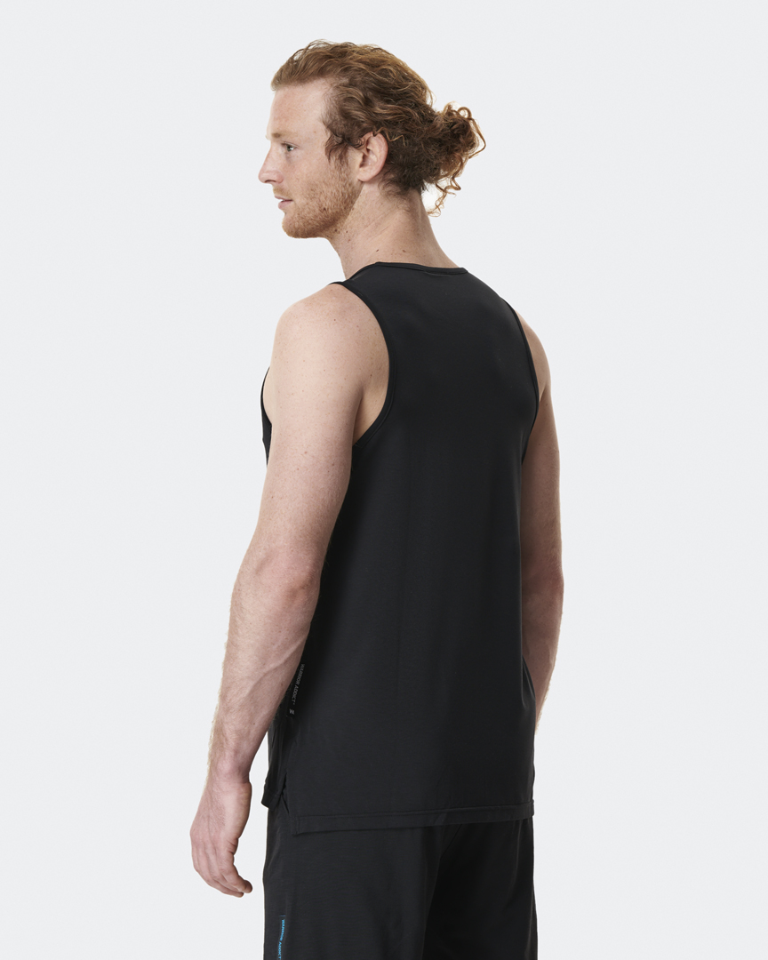 warrior addict mens yoga tops performance vest in black back shot modelled by Jacob Mellish