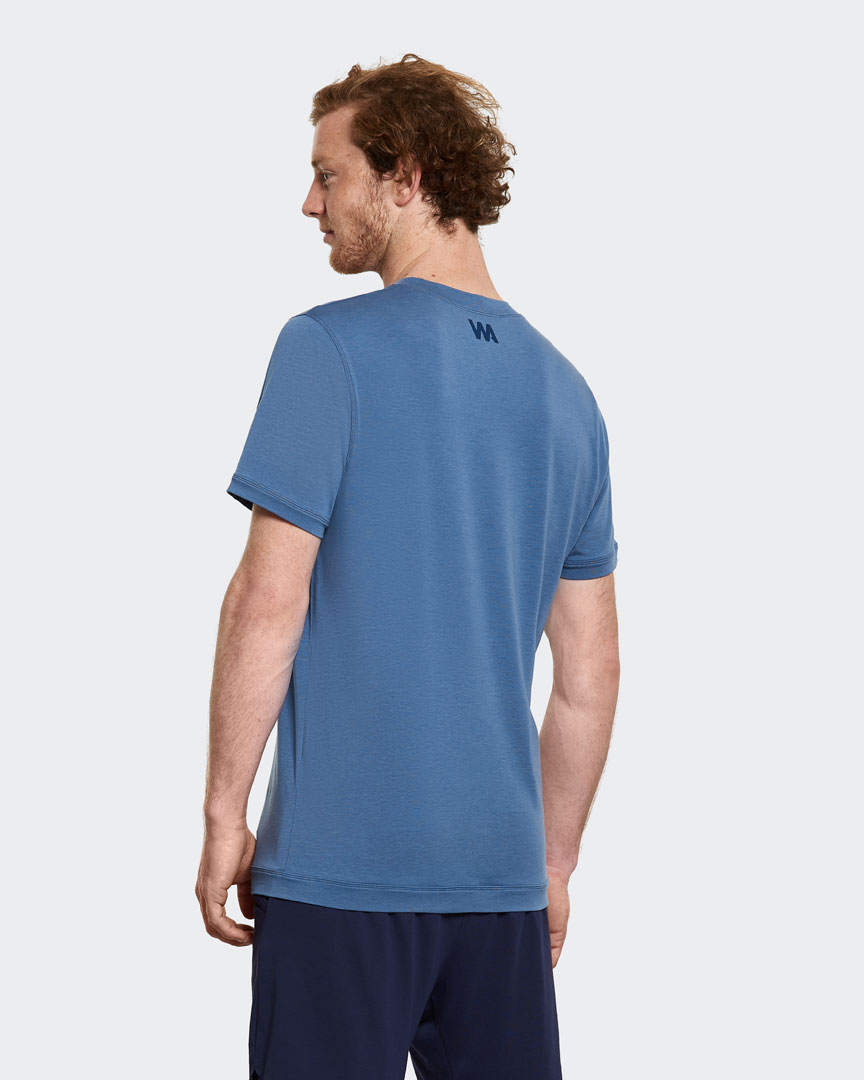 warrior addict mens yoga performance t-shirt in blue back view modelled by Jacob Mellish Yoga