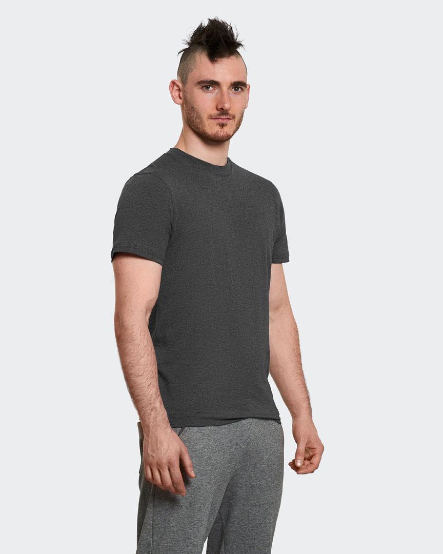 warrior addict mens yoga performance t-shirt in dark grey front view  modelled by Ben Harrison Yoga