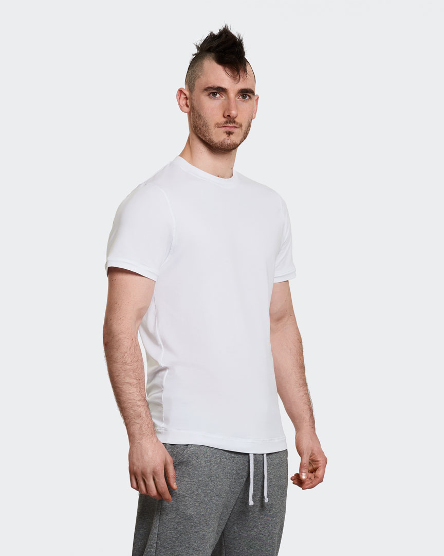 warrior addict mens yoga performance t-shirt in white front modelled by Ben Harrison yoga