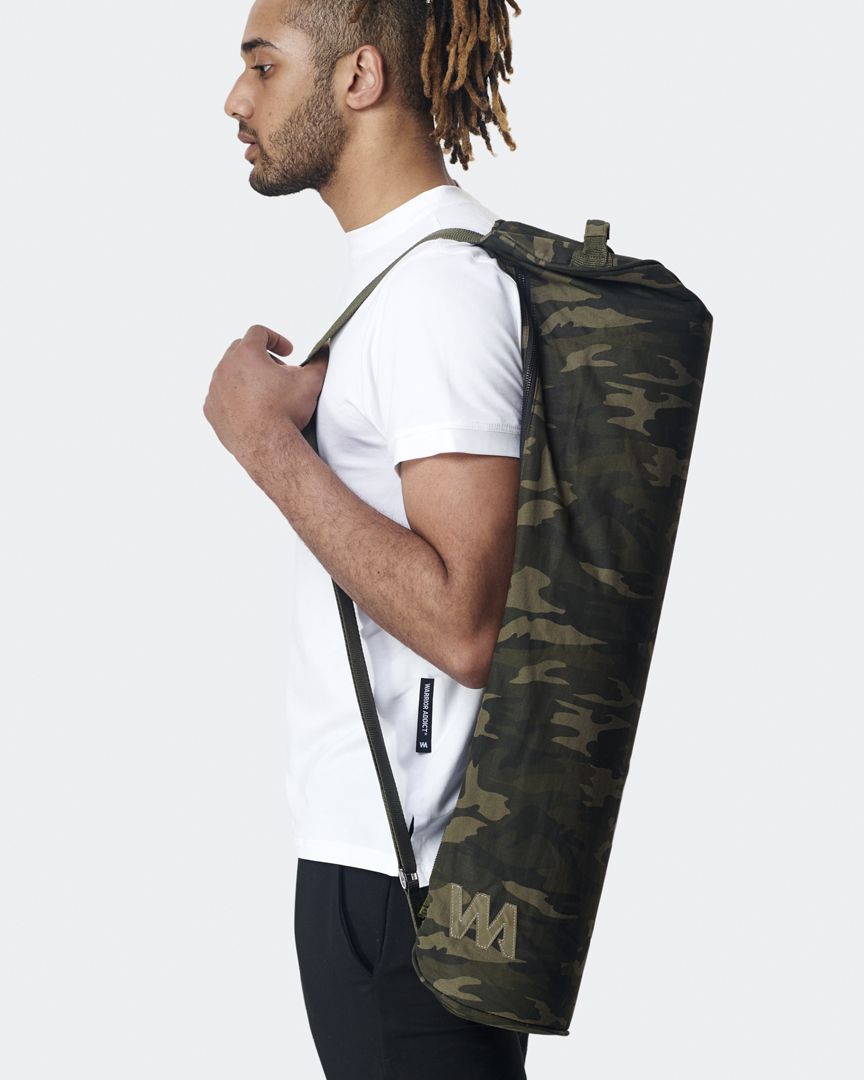 warrior addict warrior large yoga mat bag in camo print held over the shoulder