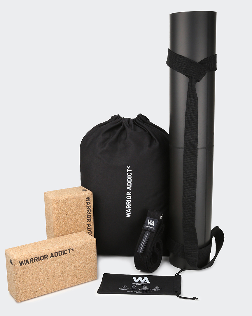 eco friendly yoga gift set for him which includes an eco-friendly black yoga mat, x 2 cork yoga blocks, an organic cotton yoga strap, a yoga mat carry strap and a free online yoga course