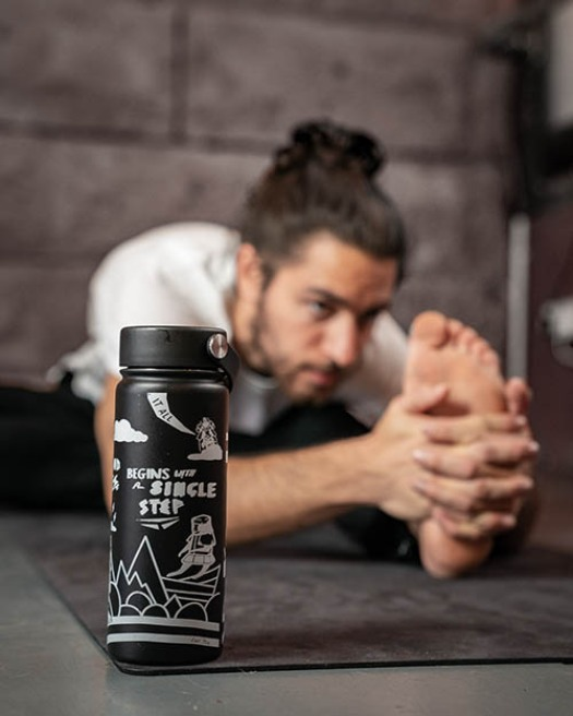 Warrior Addict Step W Hydro Water Flask in Black With A Graphic Design Warrior Print  Modelled By Joa Gomez Yoga