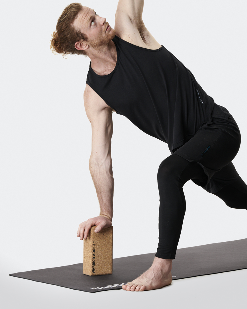the warrior addict cork yoga block demonstrated by Jacob Mellish in a side twist