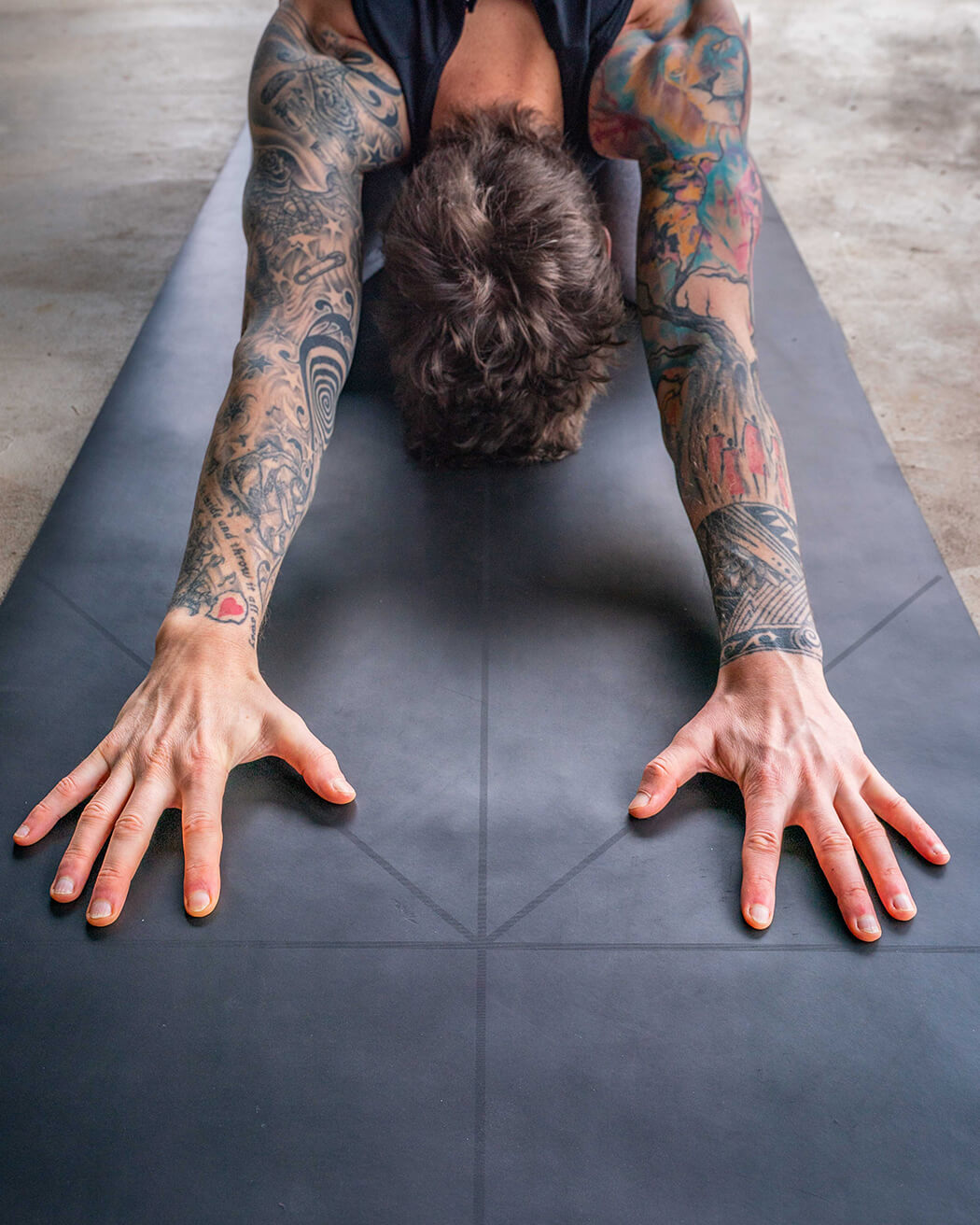 The Warrior Yoga Mat For Men By Warrior Addict In Black Rubber With Alignment Lines In Use By Andrew Macdonald Photographer