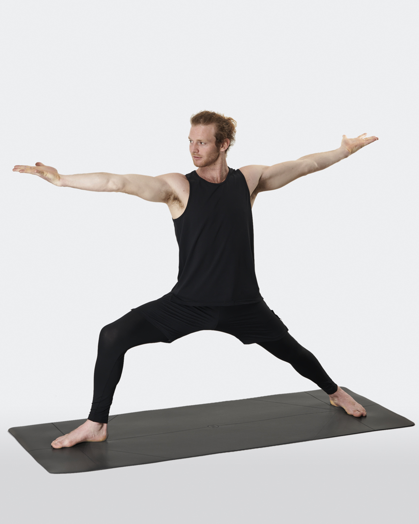 warrior addict the warrior yoga mat in black with alignment lines model Jacob Mellish