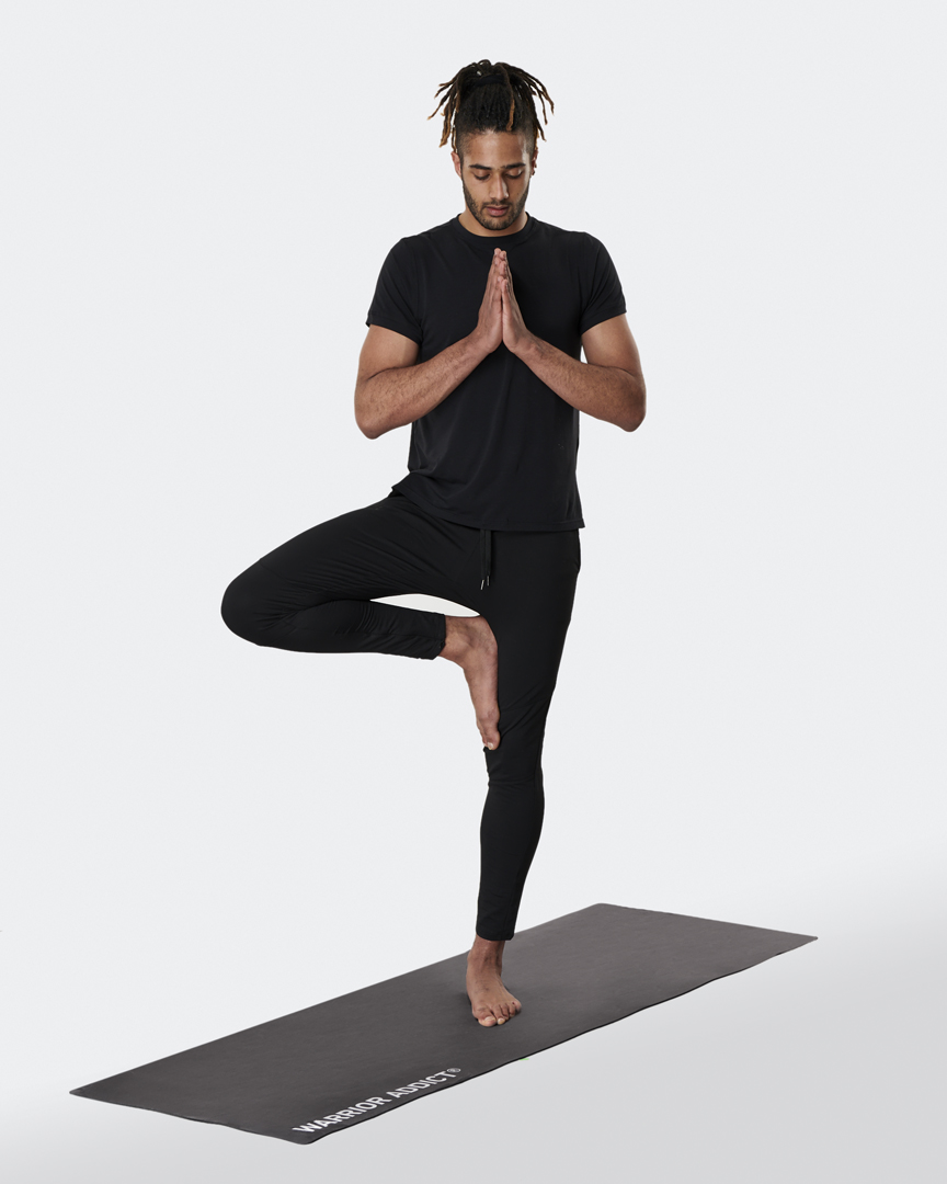warrior addict the warrior light weight yoga mat in micro fibre with branding model doing a tree pose