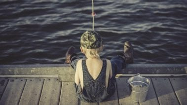 Kid Fishing to make metaphor in fishing for leads