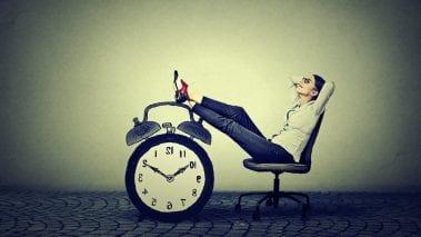 Feet up on a clock