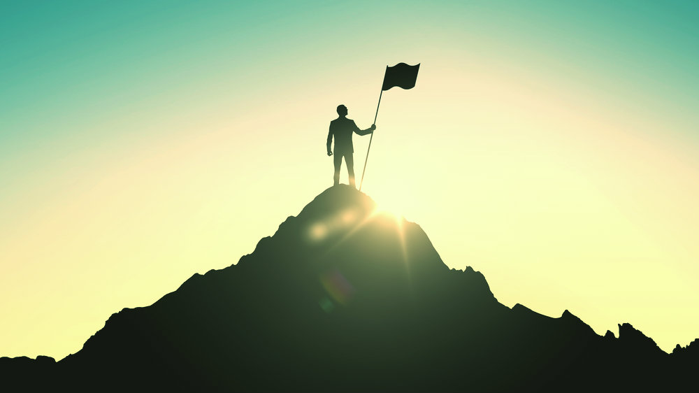man on the top of a mountain
