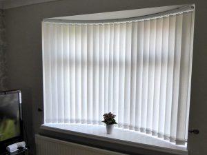 Curved track vertical blinds