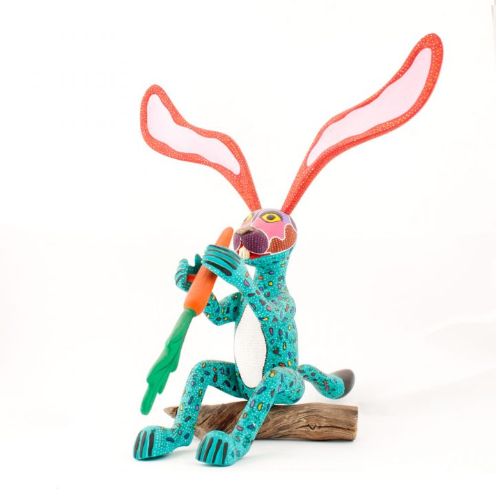 Mexican wood carving rabbit with carrot